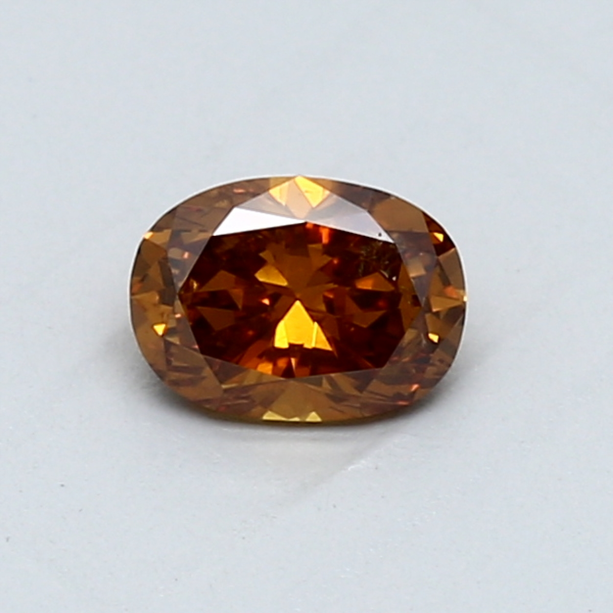 0.54-Carat Deep Brownish Yellowish Orange Oval Diamond